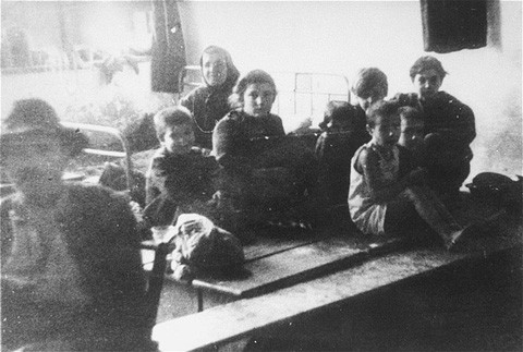 "<p>Jews from Bulgarian-occupied Macedonia who were rounded up and assembled at the Tobacco Monopoly transit camp in Skopje before deportation to the <a href=""/narrative/3819"">Treblinka</a> killing center. Skopje, <a href=""/narrative/6153"">Yugoslavia</a>, March 1943.</p>