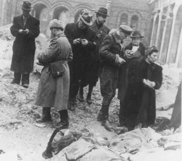 <p>Families and friends of Jewish victims killed in the Budapest ghetto search for the exhumed corpses of friends and relatives. Budapest, Hungary, January, 1945.</p>