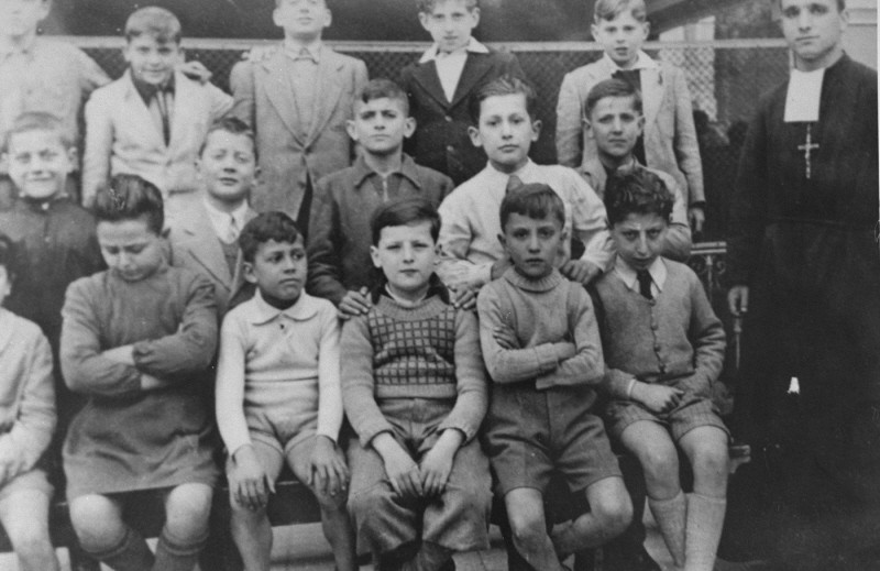 <p>Class photograph of students at the San Leone Magno Fratelli Maristi boarding school in Rome.Pictured in the top row at the far right is Zigmund Krauthamer, a Jewish child who was being hidden at the school.Rome, Italy, 1943–44.</p>