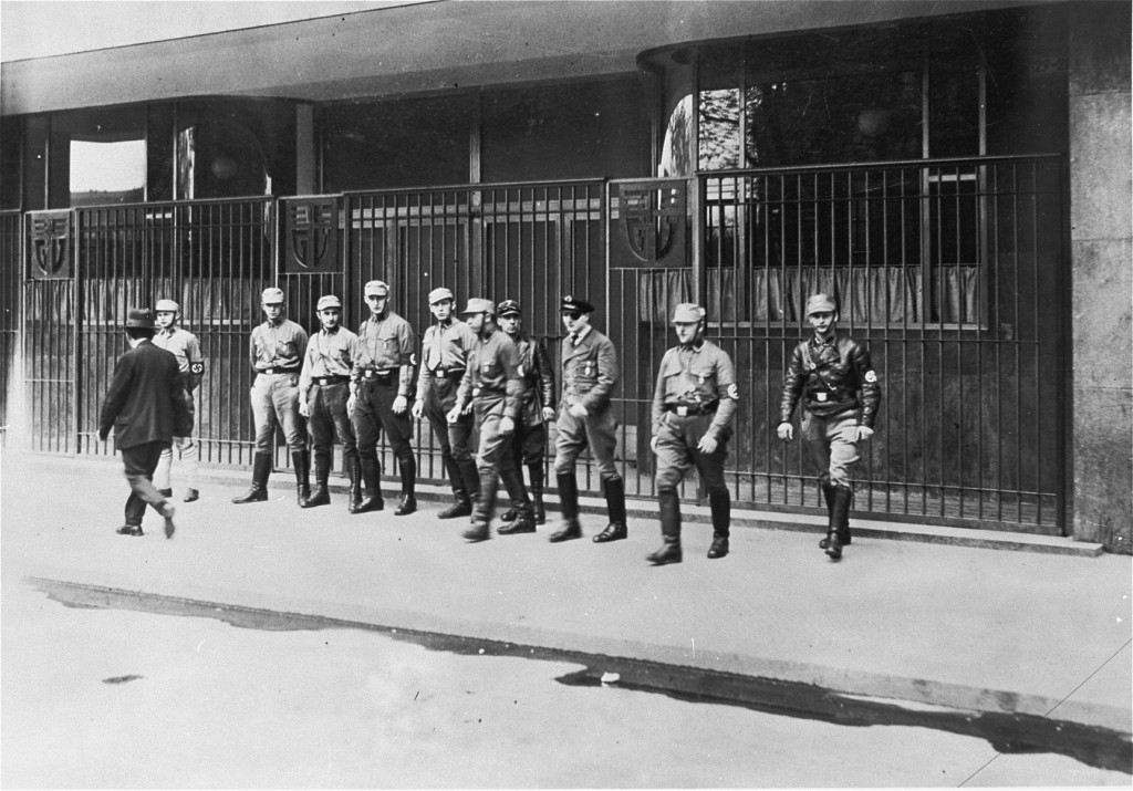 Nazi Storm Troopers (SA) block the entrance to a trade union building that they have occupied. [LCID: 78571]