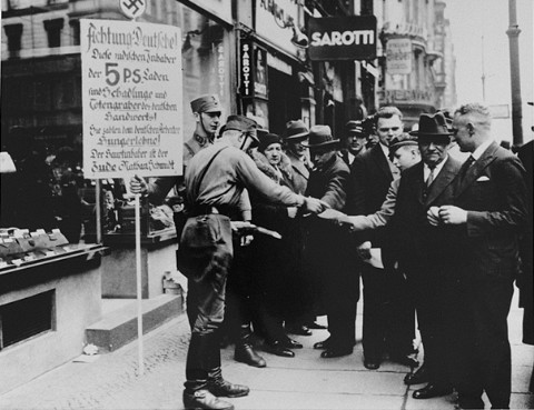 <p>SA men distribute leaflets during the anti-Jewish boycott. Berlin, Germany, 1933.</p>