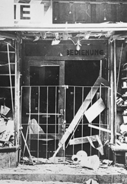<p>The exterior of a Jewish-owned business damaged by Austrian Nazi terror bombing before the annexation of Austria. Vienna, Austria, between 1933 and 1938.</p>