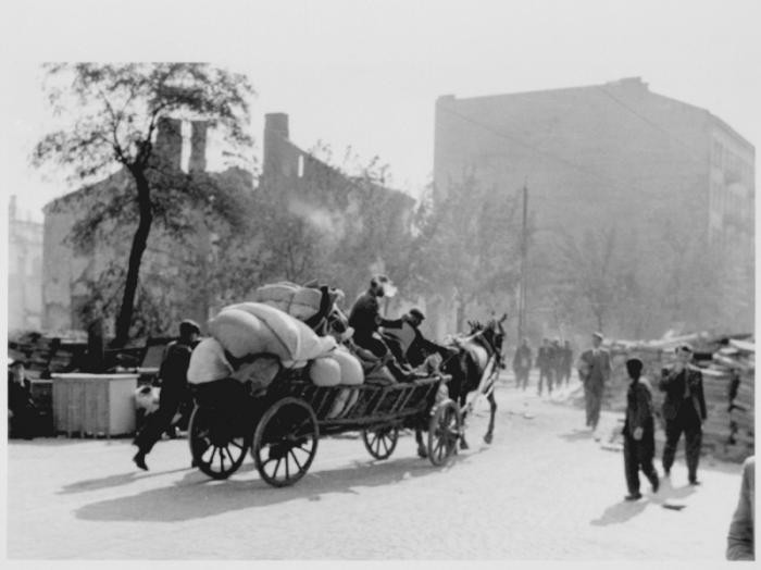 """<p>Civilians flee Warsaw following the German invasion of Poland.</p> <p>Hundreds of thousands of both <a href=""""/narrative/7045/en"""">Jewish refugees</a> and non-Jewish refugees fled the advancing German army into eastern Poland, hoping that the Polish army would halt the German advance in the west. Many of the refugees fled without a specific destination in mind. They traveled on foot or by any available transport—cars, bicycles, carts, or trucks—clogging roads to the east. Most took only what they could carry.</p>"""