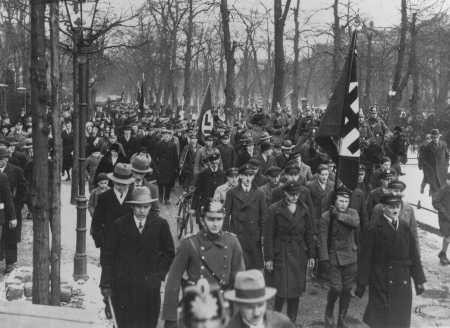 A march supporting the Nazi movement during an election campaign in 1932. [LCID: 45103]