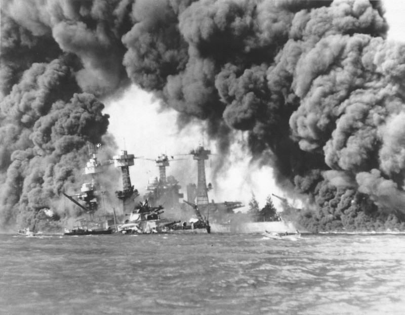 Smoke billows out from US ships hit during the Japanese air attack on Pearl Harbor, Hawaii, December 7, 1941. [LCID: 66238]