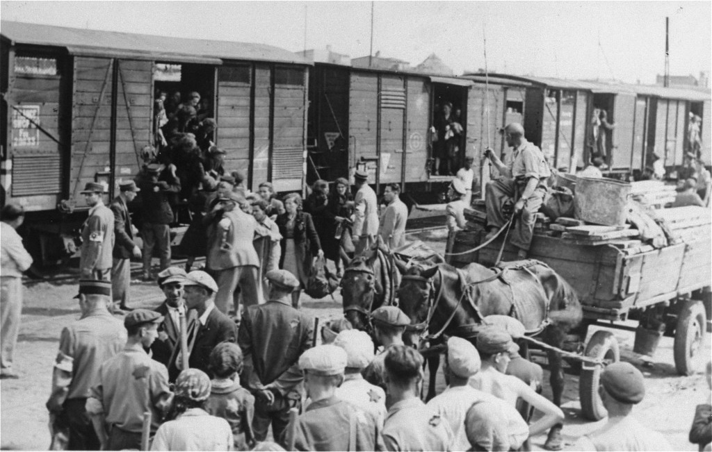 <p>Jews from the Lodz ghetto are loaded onto freight trains for deportation to the Chelmno killing center. Lodz, Poland, 1942–44.</p>