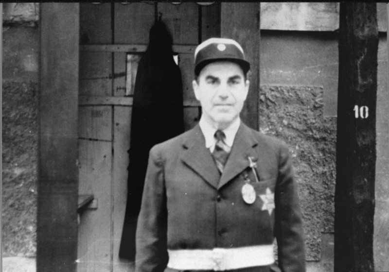 Photograph of a Jewish policeman taken during an International Red Cross visit to the Theresienstadt ghetto. [LCID: 73351]