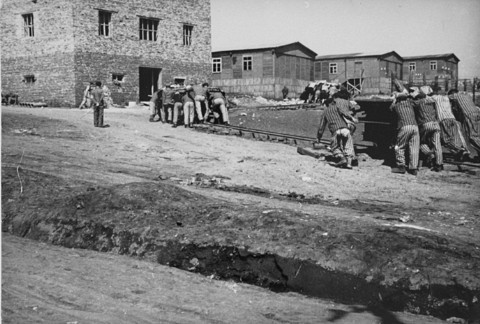 <p>Jewish prisoners at forced labor in the Plaszow camp. Plaszow, Poland, 1943-1944.</p>
