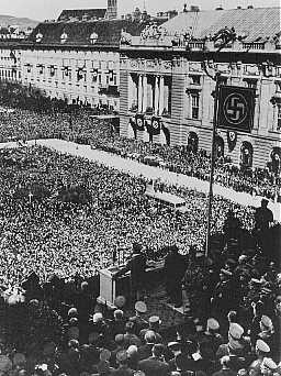 Hitler addresses a jubilant crowd on Vienna's Heldenplatz after Germany annexed Austria (the Anschluss). [LCID: 65595]