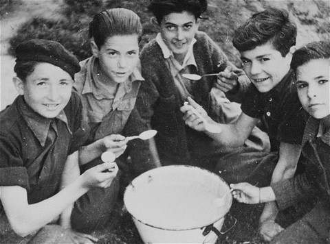 <p>Spanish refugee children interned in the Gurs camp. These children often helped members of the American Friends Service Committee, a Quaker organization, in their relief work inside the camp. Gurs, France, 1943.</p>