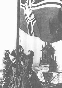 <p>The Nazi flag is raised over the Krakow castle. Krakow, Poland, 1939.</p>