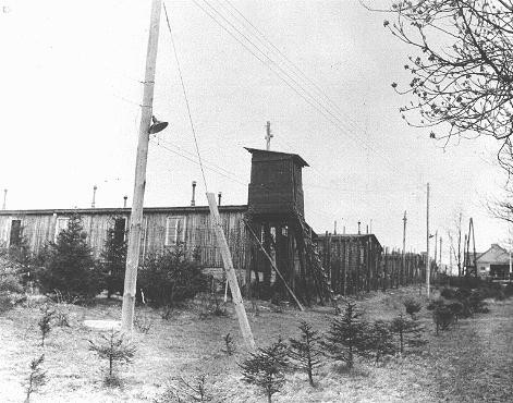 View of a watchtower and prisoner barracks at the Ohrdruf subcamp of the Buchenwald concentration camp, soon after US forces liberated ... [LCID: 85351]