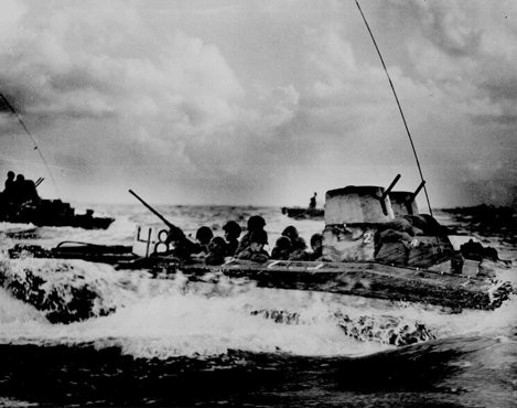 An amphibious troop carrier loaded with American Marines heads for the beaches of Tinian, an island in the Pacific Ocean. [LCID: na201]