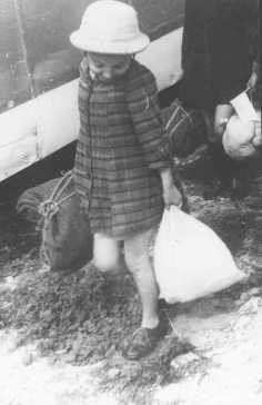 """<p>A Jewish girl, one of the """"Tehran Children"""" (about 1,000 Polish Jewish refugee children who reached Palestine), upon arrival at the Atlit train station. Palestine, February 18, 1943.</p>"""