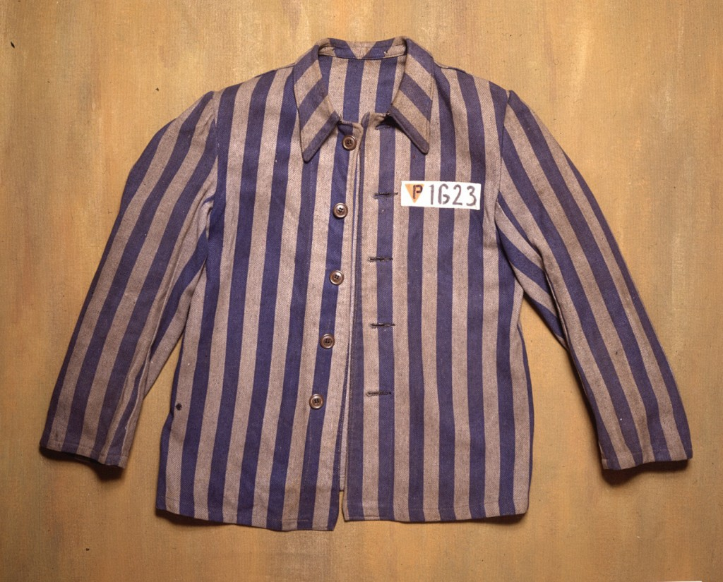 """<p>A blue and gray striped jacket from the Flossenbürg concentration camp. The letter """"P"""" on the left front of the jacket indicates that it was worn by a Polish, non-Jewish prisoner. """"P"""" stands for """"Pole"""" in German. The jacket was donated to the United States Holocaust Memorial Museum by the prisoner who wore it, Julian Noga.</p>"""