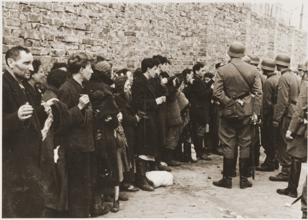 German soldiers interrogate Jews captured during the Warsaw ghetto uprising. [LCID: 46194]