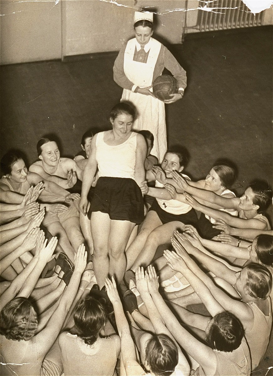 Members of the Nazi girls' organization, the League of German Girls (BDM), do a group exercise. [LCID: 09649]