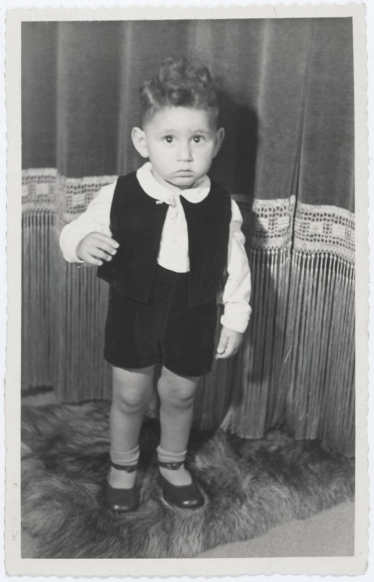 "<p>Jewish child Hans van den Broeke (born Hans Culp) in <a href=""/narrative/7711"">hiding</a> in the Netherlands. He is 2 years old in this photograph.</p>"