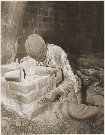 """<p>The charred corpse of a prisoner killed by the SS in a barn just outside of <a href=""""/narrative/8101"""">Gardelegen</a>.<span style=""""font-weight: 400;"""">The SS guards locked the prisoners, who were on a death march from the Dora-Mittelbau camp, in a barn, which was then set ablaze.</span>Gardelegen, Germany, April 16, 1945.</p> <p><span style=""""font-weight: 400;"""">This image is among the </span><a href=""""/narrative/8334/en""""><span style=""""font-weight: 400;"""">commonly reproduced and distributed</span></a><span style=""""font-weight: 400;"""">, and often extremely graphic, images of liberation. These photographs provided powerful documentation of the crimes of the Nazi era. </span></p>"""