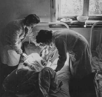 Soon after liberation, a camp survivor receives medical care. [LCID: 46362]