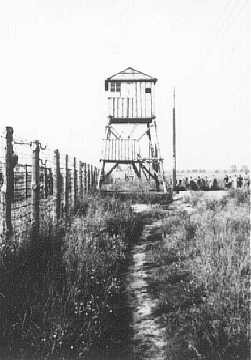 View of watchtower and fence at the Majdanek camp, post liberation. [LCID: 50511]