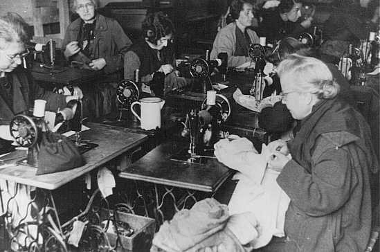 <p>Forced laborers at work in a tailor's workshop. Theresienstadt ghetto, Czechoslovakia, between 1941 and 1945.</p>
