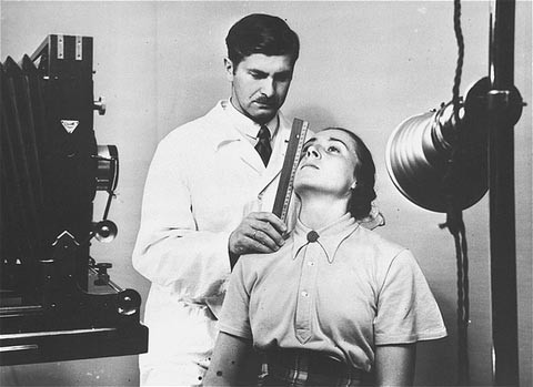 At the Kaiser Wilhelm Institute for Anthropology, Human Genetics, and Eugenics, a racial hygienist measures a woman's features in ... [LCID: 78569]