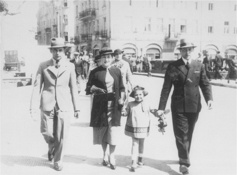 "<p>A Jewish family strolls along a street in prewar <a href=""/narrative/7584"">Kalisz</a>. Poland, May 16, 1935.</p>"