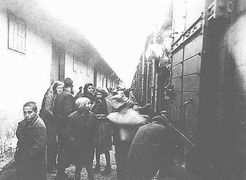 "<p>Macedonian Jews prepare to board a deportation train in Skopje. Skopje, <a href=""/narrative/6153/en"">Yugoslavia</a>, March 1943.</p> <p><span style=""font-weight: 400;"">The Jews of <a href=""/narrative/5955/en"">Bulgarian-occupied</a> Thrace and Macedonia were deported in March 1943. On March 11, 1943, over 7,000 Macedonian Jews from Skopje, Bitola, and Stip were rounded up and assembled at the Tobacco Monopoly in Skopje, whose several buildings had been hastily converted into a transit camp. The Macedonian Jews were kept there between eleven and eighteen days, before being deported by train in three transports between March 22 and 29, to the <a href=""/narrative/3819/en"">Treblinka killing center</a>.</span></p>"