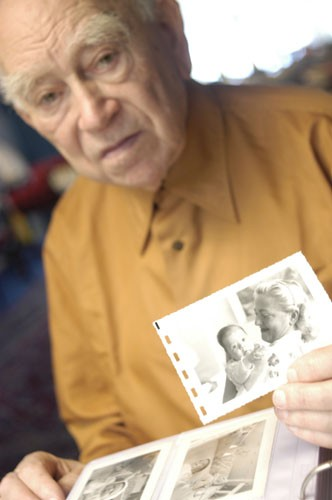 """<p><a href=""""/narrative/10265"""">Norman Salsitz</a> holds a photograph of his wife, Amalie, and daughter, Esther. 2004.</p> <p><span style=""""font-weight: 400;"""">With the end of World War II and collapse of the Nazi regime, survivors of the Holocaust faced the daunting task of <a href=""""/narrative/10475"""">rebuilding their lives.</a> With little in the way of financial resources and few, if any, surviving family members, most eventually emigrated from Europe to start their lives again. Between 1945 and 1952, more than 80,000 Holocaust survivors immigrated to the United States. Norman was one of them. </span></p>"""