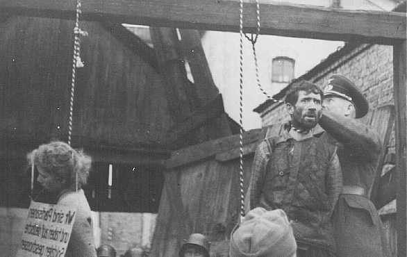 """<p>Masha Bruskina, a Jewish Soviet partisan hanged with two other partisans, Kiril Trus and Volodya Sherbateyvich. The sign reads: """"We are partisans who shot at German soldiers."""" Minsk, Soviet Union, October 26, 1941.</p>"""