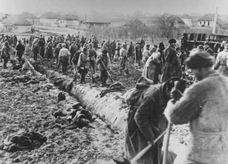 "<p><a href=""/narrative/10135"">Soviet prisoners of war</a> at forced labor build a road. Probably in the Soviet Union, about 1943.</p>"