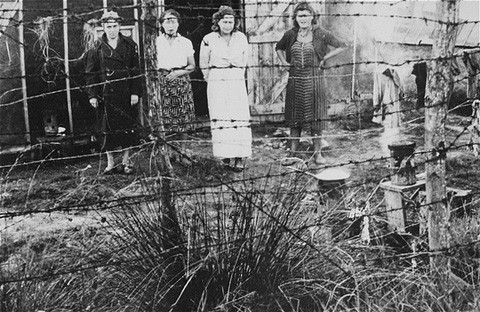 Jewish women prisoners behind a barbed-wire fence at the Gurs detention camp. [LCID: 78704]