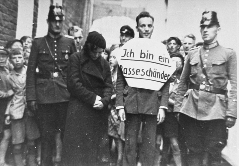 "Public humiliation: ""I am a defiler of the race."" In this photograph, a young man who allegedly had illicit relations with a Jewish ... [LCID: 79267]"
