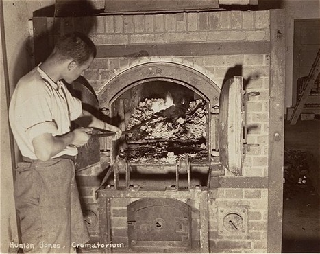 A survivor stokes smoldering human remains in a crematorium oven that is still lit. [LCID: 00315]