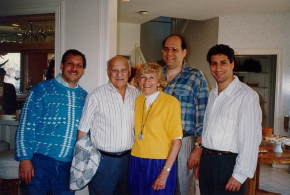 <p>Lisa and Aron (center) with their three sons, Gordon, Howard, and Daniel. Photograph probably taken in Chicago, Illinois, in 1990.</p>