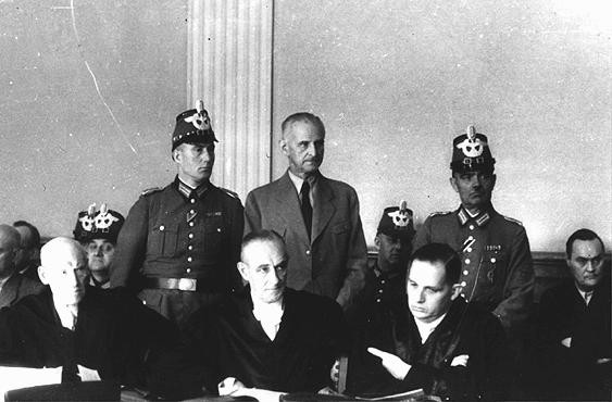 "<p>Carl Goerdeler, former mayor of Leipzig and a leader of the <a href=""/narrative/12002/en"">July 1944 conspiracy to kill Hitler</a>, stands trial before the People's Court in Berlin. He was condemned and executed at Ploetzensee prison on February 2, 1945. Berlin, Germany, 1944.</p>"