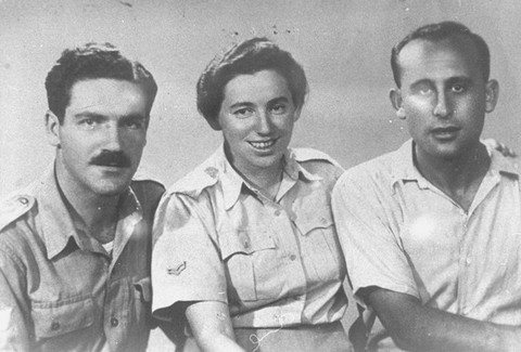 "<p>Zvi Ben-Yaakov (left) and Haviva Reik (center), <a href=""/narrative/5666"">Jewish parachutists</a> under British command. Their mission was to aid the Jews in Czechoslovakia, where they were caught by the Nazis and executed. Palestine, before September 1944.</p>"