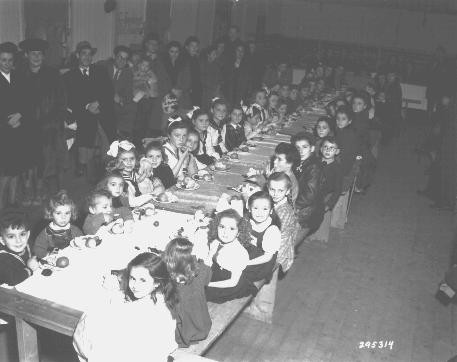 <p>A Hanukkah party for Jewish children at the Fuerth displaced persons camp. Gifts were contributed by families of Americans stationed at the Nuremberg military post. Germany, December 9, 1947.</p>
