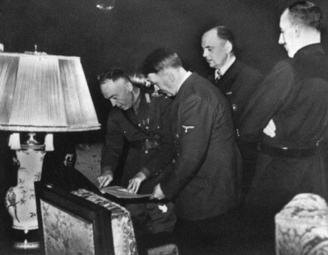 <p>In Hitler's presence, Romanian ruler Ion Antonescu signs the Three-Power Agreement. Berlin, Germany, November 23, 1940.</p>