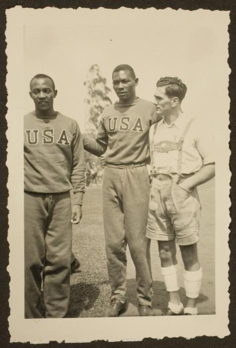 "<p><a href=""/narrative/9625"">African American athletes</a> Jesse Owens and Dave Albritton pose with a German citizen. They both competed in the <a href=""/narrative/7139"">1936 Olympic Games</a>. Albritton won the silver medal in high jump. Owens won gold medals in the 100-meter dash, 200-meter dash, broad (long) jump, and the 4x100-meter relay.</p>"