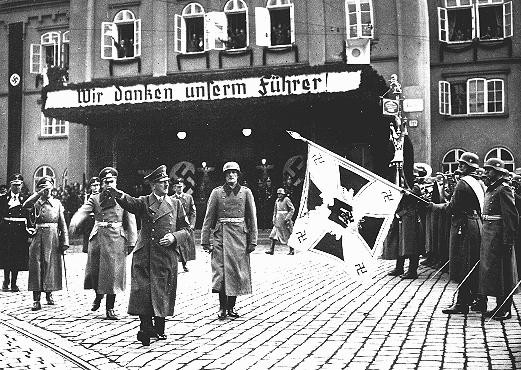 "<p>Adolf Hitler in Brno shortly after German troops occupied <a href=""/narrative/7295"">Czechoslovakia</a>. The sign reads, ""We thank our Führer."" Brno, Czechoslovakia, March 17, 1939.</p>"