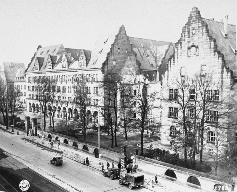 """<p>View of the Palace of Justice (left), where the <a href=""""/narrative/9366"""">International Military Tribunal</a> trial was held. Nuremberg, Germany, November 17, 1945.</p> <p>The Palace of Justice was selected by the Allied powers as the <a href=""""/narrative/9695"""">location</a> for the International Military Tribunal (IMT) because it was the only undamaged facility extensive enough to accommodate a major trial. The site contained 20 courtrooms and a prison capable of holding 1,200 prisoners.</p>"""