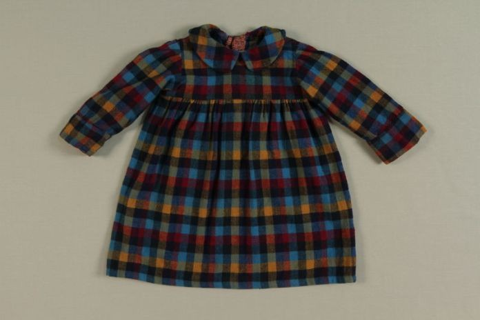 A dress worn by hidden child in Baarn, the Netherlands. [LCID: 2515787]