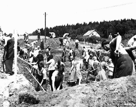 "<p>German civilians from the town of Nammering, under orders of American military authorities, dig graves for victims of a <a href=""/narrative/2931"">death march</a> from the Buchenwald concentration camp. Germany, May 1945.</p>"