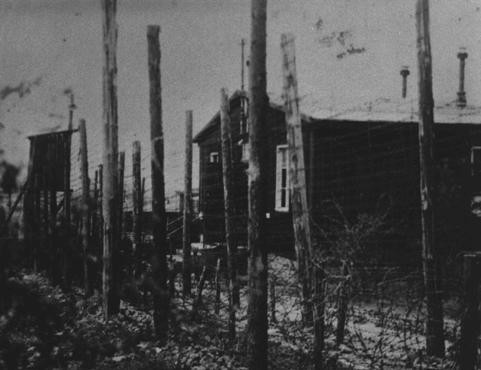 A view of the double row of barbed-wire fences that surrounded the Ohrdruf camp, a subcamp in the Buchenwald camp system. [LCID: 10278]