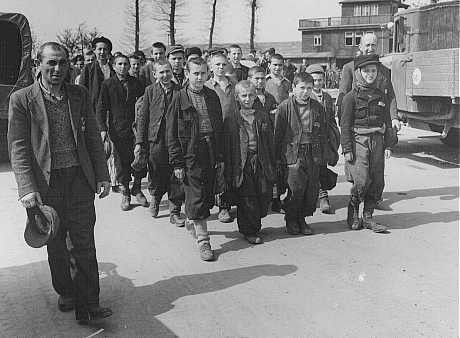 Children march out of Buchenwald to a nearby American field hospital where they will receive medical care. [LCID: 69225]