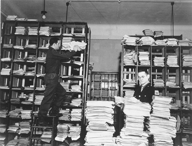 <p>US Army staffers organizing stacks of German documents collected by war crimes investigators as evidence for the International Military Tribunal.</p>