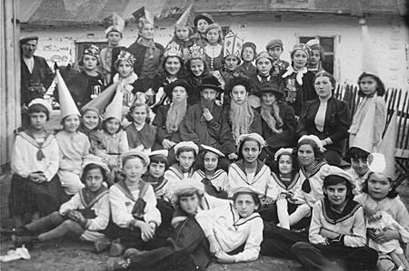 Group portrait of students at the Beis Yaakov religious school for girls dressed in costumes to celebrate the holiday of Purim. [LCID: 67180]