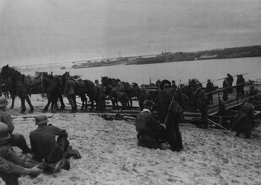 German forces and supplies at a river crossing on the way to the front. [LCID: 08779]